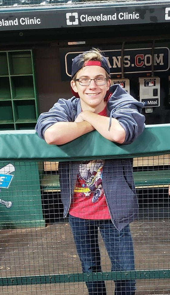 Student at a Cleveland Indians game in dugout