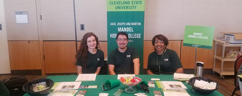 2 Honors students 1 advisor at Open house